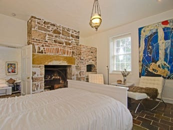 Country bedroom design idea with tiles & fireplace using beige colours - Bedroom photo 1485045