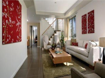 Open plan living room using red colours with slate & staircase - Living Area photo 15354477