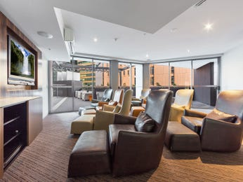 Open plan living room using brown colours with leather & floor-to-ceiling windows - Living Area photo 17164921
