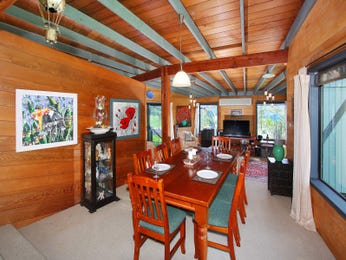 Country dining room idea with hardwood & exposed eaves - Dining Room Photo 1241397