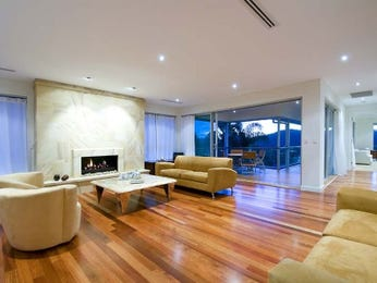 Open plan living room using beige colours with hardwood & fireplace - Living Area photo 436121