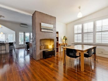 Modern dining room idea with floorboards & fireplace - Dining Room Photo 1613797