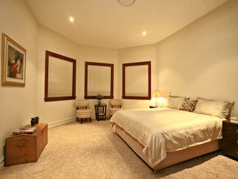 Asian-inspired bedroom design idea with floorboards & built-in shelving using cream colours - Bedroom photo 266183