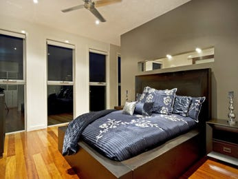 Modern bedroom design idea with floorboards & floor-to-ceiling windows using brown colours - Bedroom photo 512907