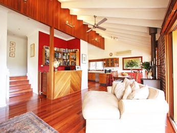 Open plan living room using brown colours with timber & built-in shelving - Living Area photo 1266457