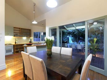 Modern dining room idea with floorboards & french doors - Dining Room Photo 734435
