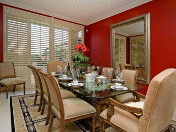Modern dining room idea with carpet & louvre windows - Dining Room Photo 267582