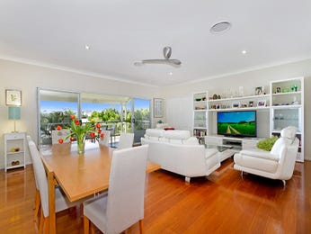 Open plan living room using white colours with floorboards & built-in shelving - Living Area photo 8333341
