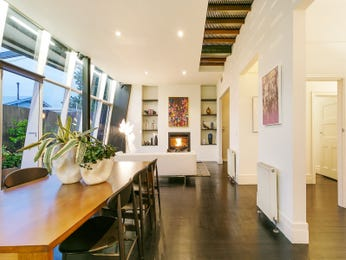 Modern dining room idea with hardwood & fireplace - Dining Room Photo 8156573