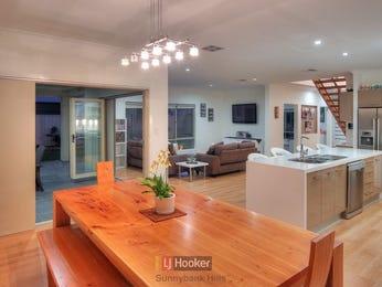 Casual dining room idea with hardwood & bi-fold doors - Dining Room Photo 1191031