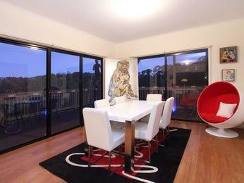 Retro dining room idea with hardwood & floor-to-ceiling windows - Dining Room Photo 830992
