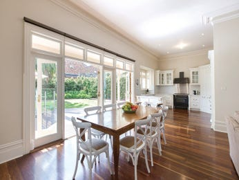 Classic dining room idea with floorboards & floor-to-ceiling windows - Dining Room Photo 16908041