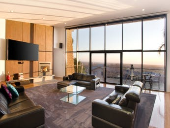 Open plan living room using black colours with leather & floor-to-ceiling windows - Living Area photo 16984813