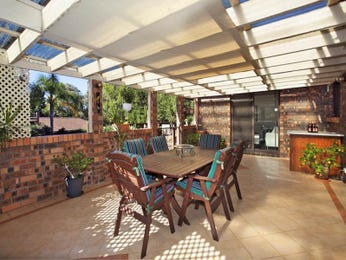 Walled outdoor living design with bbq area & shade sail using brick - Outdoor Living Photo 1558122