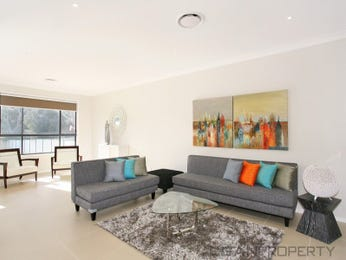 Open plan living room using cream colours with carpet & bay windows - Living Area photo 1536680