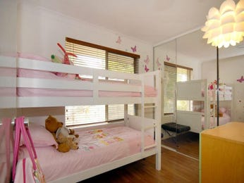 Children's room bedroom design idea with floorboards & sliding doors using brown colours - Bedroom photo 435412