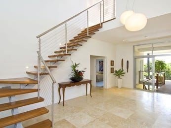 Open plan living room using white colours with timber & staircase - Living Area photo 1027608