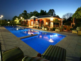 In-ground pool design using natural stone with cabana & decorative lighting - Pool photo 466656