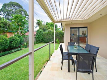 Indoor-outdoor outdoor living design with verandah & hedging using tiles - Outdoor Living Photo 434933