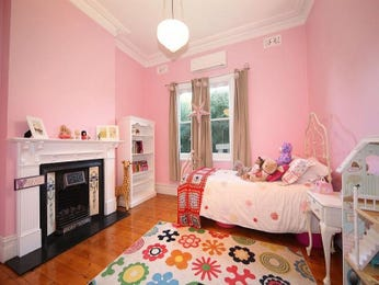 Children's room bedroom design idea with floorboards & fireplace using pink colours - Bedroom photo 1247574