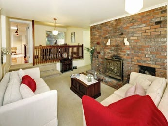 Open plan living room using white colours with carpet & fireplace - Living Area photo 1165207