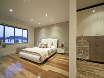 Modern bedroom design idea with floorboards & built-in wardrobe using beige colours - Bedroom photo 322079