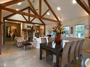Country dining room idea with polished concrete & exposed eaves - Dining Room Photo 1217712