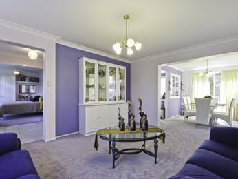 Open plan living room using purple colours with tiles & built-in shelving - Living Area photo 1085357
