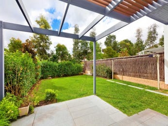 Walled outdoor living design with pergola & hedging using grass - Outdoor Living Photo 1253441