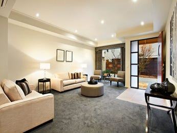 Open plan living room using neutral colours with carpet & bay windows - Living Area photo 323455