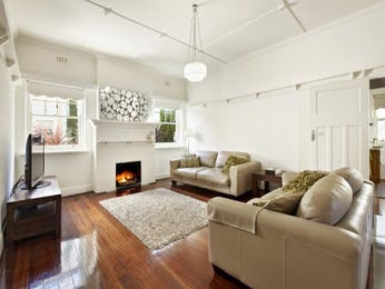 Open plan living room using white colours with carpet & fireplace - Living Area photo 1145801