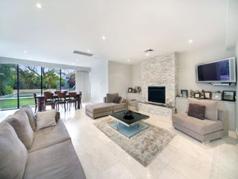 Dining-living living room using white colours with tiles & fireplace - Living Area photo 983498