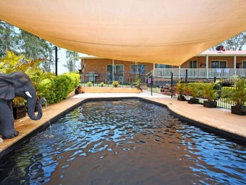 In-ground pool design using slate with cabana & fountain - Pool photo 529667