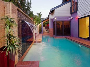 In-ground pool design using tiles with retaining wall & decorative lighting - Pool photo 1039418