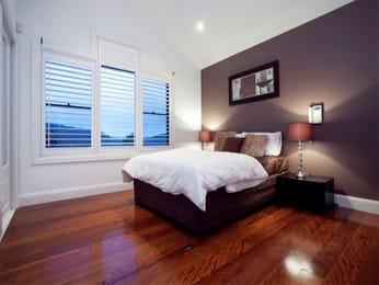 Retro bedroom design idea with floorboards & louvre windows using black colours - Bedroom photo 351556