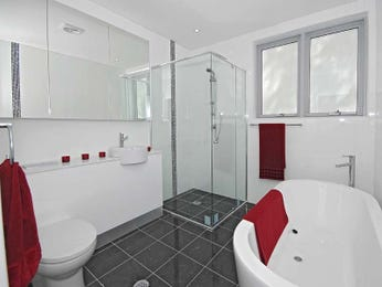 Modern bathroom design with freestanding bath using tiles - Bathroom Photo 454825