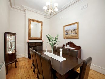 Classic dining room idea with floorboards & fireplace - Dining Room Photo 1436559