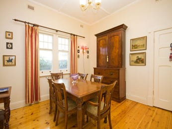 Classic dining room idea with floorboards & sash windows - Dining Room Photo 724899