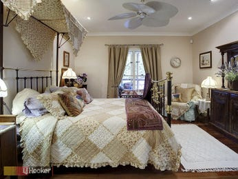 Country bedroom design idea with floorboards & balcony using beige colours - Bedroom photo 324998