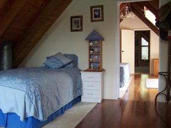 Period bedroom design idea with floorboards & exposed eaves using blue colours - Bedroom photo 427546