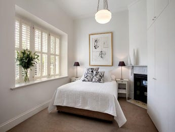 Romantic bedroom design idea with carpet & fireplace using beige colours - Bedroom photo 674866