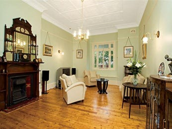 Dining-living living room using green colours with floorboards & mantelpiece - Living Area photo 415548