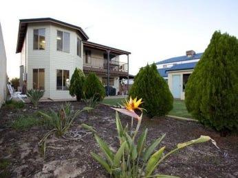 Low maintenance garden design using grass with balcony & outdoor furniture setting - Gardens photo 534325