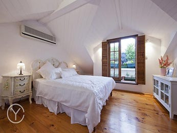 Period bedroom design idea with floorboards & exposed eaves using brown colours - Bedroom photo 567838