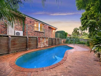 In-ground pool design using brick with decking & rockery - Pool photo 1166110