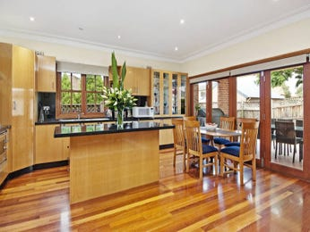 Casual dining room idea with floorboards & bi-fold doors - Dining Room Photo 341227
