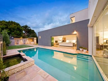 In-ground pool design using grass with retaining wall & decorative lighting - Pool photo 1183432