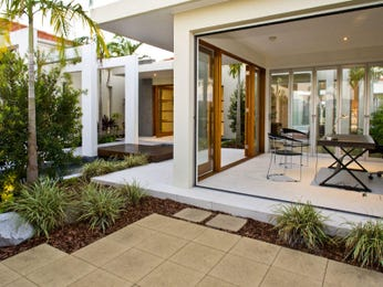 Indoor-outdoor outdoor living design with verandah & hedging using natural stone - Outdoor Living Photo 437286