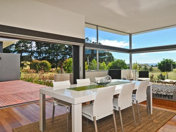 Casual dining room idea with floorboards & floor-to-ceiling windows - Dining Room Photo 1090764