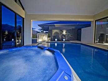 Endless pool design using grass with cabana & decorative lighting - Pool photo 518096